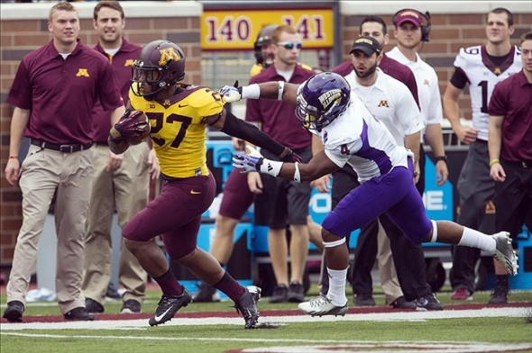 Sep 14, 2013; Minneapolis, MN, USA; Minnesota Golden Gophers running back David Cobb (27) runs with the ball past Western Illinois Leathernecks defensive back Jonathon Rollins (4) at TCF Bank Stadium. The Gophers won 29-12. Mandatory Credit: Jesse Johnson-USA TODAY Sports