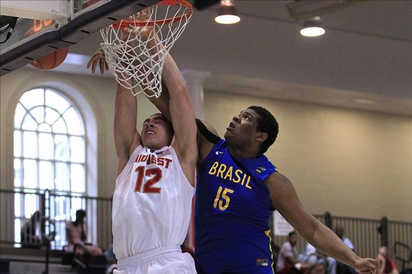 Jul 18, 2013; Washington, DC, USA; Team USA Midwest player Reid Travis (12) attempts to dunk the ball against Team Brasil during the Nike Global Challenge at Trinity University in Washington, DC. Mandatory Credit: Geoff Burke-USA TODAY Sports