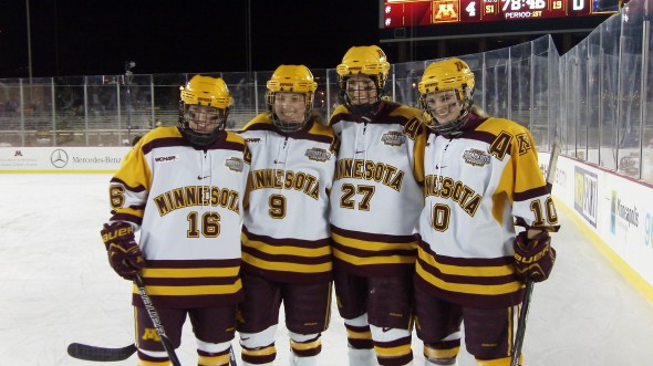 Minnesota women's hockey seniors Bethany Brausen, Sarah Davis, Baylee Gillanders, and Kelly Terry poise for a picture after defeating Minnesota State-Mankato in the Hockey City Classic at TCF Bank Stadium. (Steve Pesek, Gold and Gopher, 2014)