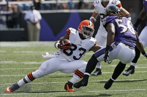 Sep 15, 2013; Baltimore, MD, USA; Cleveland Browns running back Trent Richardson (33) runs for a gain before being tackled by Baltimore Ravens linebacker Josh Bynes (56) at M