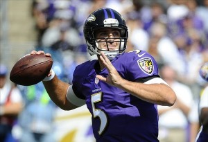 Sep 15, 2013; Baltimore, MD, USA; Baltimore Ravens quarterback Joe Flacco (5) drops back to pass against the Cleveland Browns during the first half at M