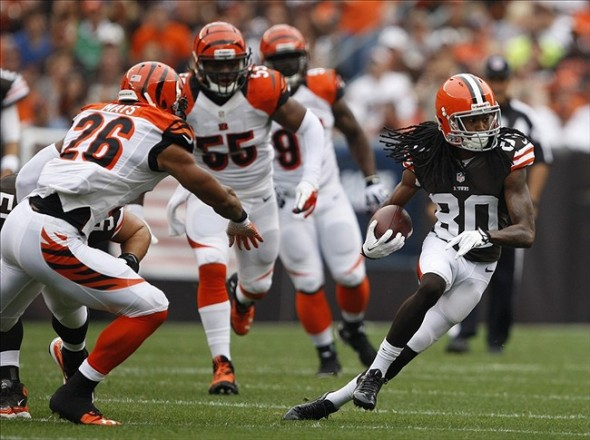 Sep 29, 2013; Cleveland, OH, USA; Cleveland Browns wide receiver Travis Benjamin (80) runs after a catch during the first quarter against the Cincinnati Bengals at FirstEnergy Stadium. Mandatory Credit: Raj Mehta-USA TODAY Sports