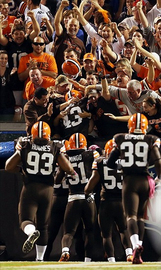 Oct 3, 2013; Cleveland, OH, USA; Cleveland Browns strong safety T.J. Ward (43) celebrates with fans and teammates after returning an interception for a touchdown against the Buffalo Bills during the fourth quarter at FirstEnergy Stadium. The Browns won 37-24. Mandatory Credit: Ron Schwane-USA TODAY Sports