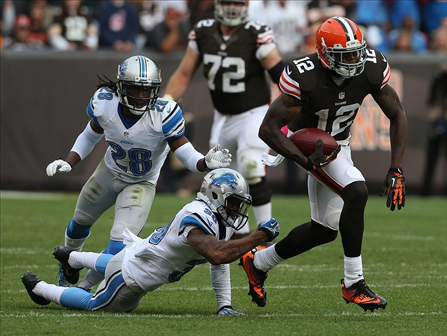 Oct 13, 2013; Cleveland, OH, USA; Cleveland Browns wide receiver Josh Gordon (12) against Detroit Lions cornerback Darius Slay (30) and cornerback Bill Bentley (28) during the fourth quarter at FirstEnergy Stadium. The Lions won 31-17. Mandatory Credit: Ron Schwane-USA TODAY Sports