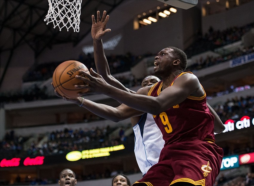 Feb 3, 2014; Dallas, TX, USA; Cleveland Cavaliers small forward Luol Deng (9) drives to the basket past Dallas Mavericks center Samuel Dalembert (1) during the second half at the American Airlines Center. The Mavericks defeated the Cavaliers 124-107. Mandatory Credit: Jerome Miron-USA TODAY Sports