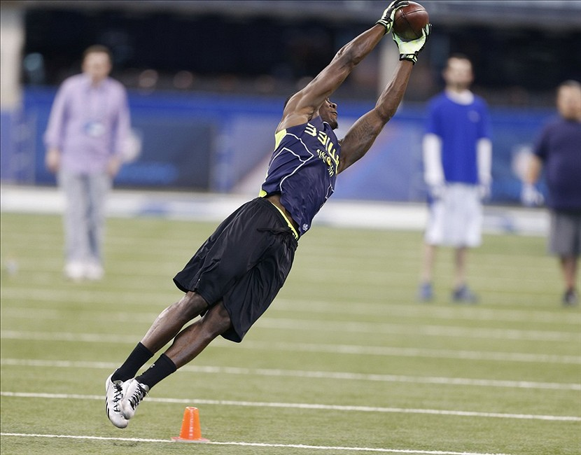 Feb 23, 2014; Indianapolis, IN, USA; USC Trojans wide receiver Marqise Lee participates in a pass catching drill during the 2014 NFL Combine at Lucas Oil Stadium. Mandatory Credit: Brian Spurlock-USA TODAY Sports