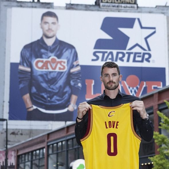 Kevin Love Next to Kevin Love Banner