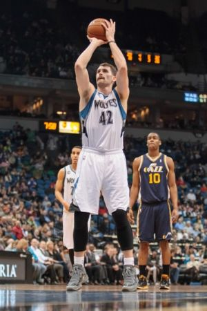 Apr 16, 2014; Minneapolis, MN, USA; Minnesota Timberwolves forward Kevin Love (42) shoots at Target Center. Mandatory Credit: Brad Rempel-USA TODAY Sports