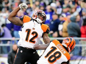 Nov 10, 2013; Baltimore, MD, USA; Cincinnati Bengals wide receiver A.J. Green (18) is congratulated by wide receiver Mohamed Sanu (12) after catching a 51 yard touchdown pass as time expired against the Baltimore Ravens at M