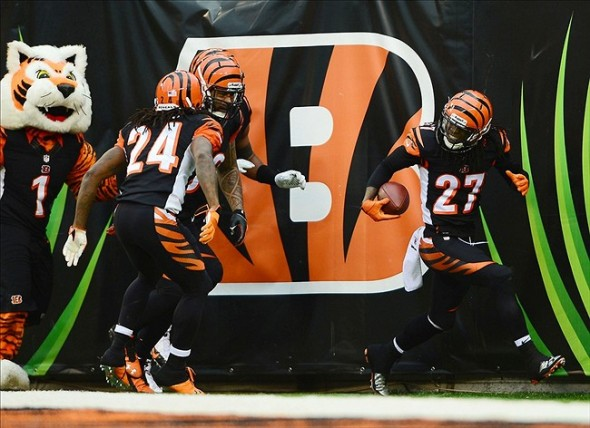 Dec 29, 2013; Cincinnati, OH, USA; Cincinnati Bengals cornerback Dre Kirkpatrick (27) celebrates with teammates after intercepting a pass and running for a touchdown during the fourth quarter against the Baltimore Ravens at Paul Brown Stadium. Mandatory Credit: Andrew Weber-USA TODAY Sports