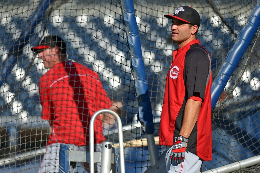 Jun 30, 2014; San Diego, CA, USA; Cincinnati Reds first baseman Joey Votto (right) watches the flight of a ball hit by left fielder Ryan Ludwick (48) during batting practice before a game against the San Diego Padres at Petco Park. Mandatory Credit: Jake Roth-USA TODAY Sports