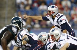 Aug 15, 2014; Foxborough, MA, USA; New England Patriots quarterback Tom Brady (12) calls a play against the Philadelphia Eagles during the first half at Gillette Stadium. Mandatory Credit: Mark L. Baer-USA TODAY Sports