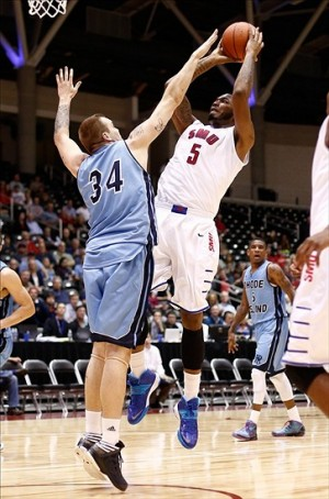 Nov 11, 2013; Garland, TX, USA; Southern Methodist Mustangs forward Markus Kennedy (5) shoots against Rhode Island Rams forward Mike Aaman (34) during the first half at Curtis Culwell Center. Mandatory Credit: Jim Cowsert-USA TODAY Sports