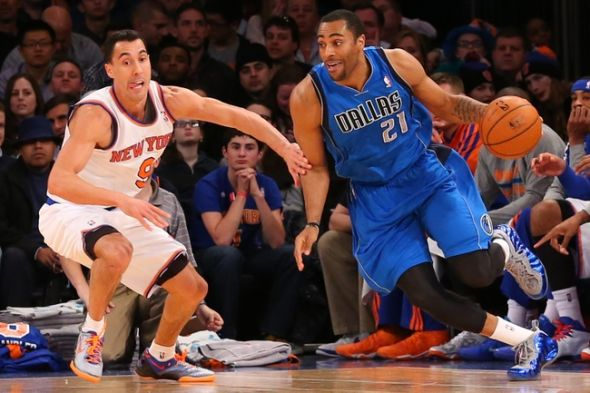 Feb 24, 2014; New York, NY, USA; Dallas Mavericks shooting guard Wayne Ellington (21) dribbles the ball around New York Knicks point guard Pablo Prigioni (9) during the fourth quarter at Madison Square Garden. Dallas Mavericks won 110-108. Mandatory Credit: Anthony Gruppuso-USA TODAY Sports