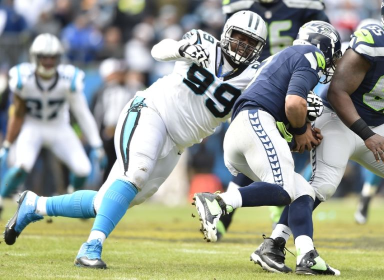 Kawann-short-russell-wilson-nfl-nfc-divisional-seattle-seahawks-carolina-panthers-768x561