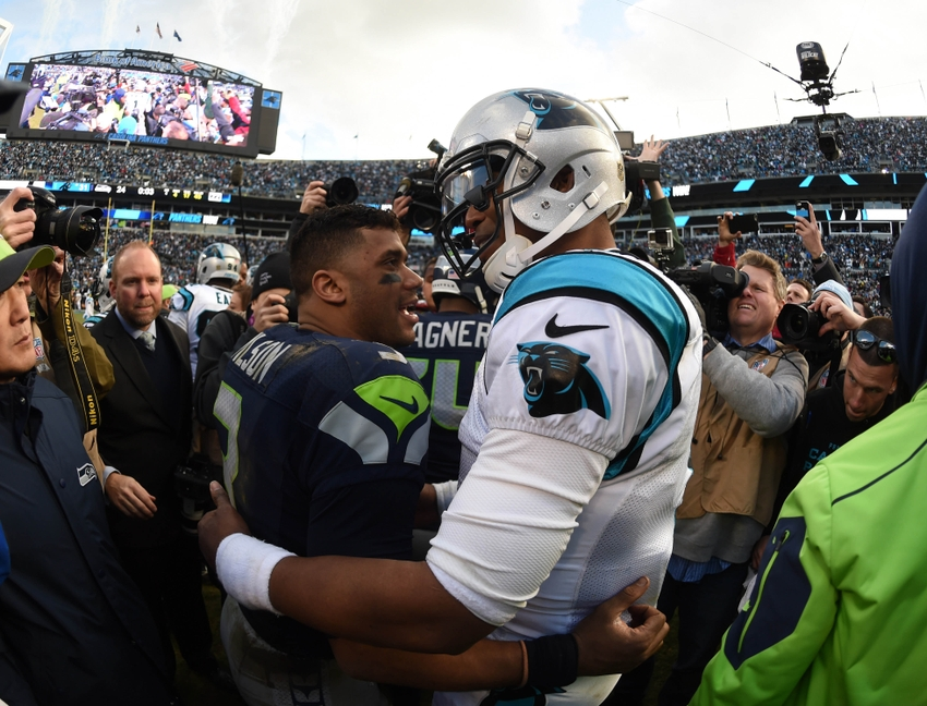 9081206-cam-newton-russell-wilson-nfl-nfc-divisional-seattle-seahawks-carolina-panthers