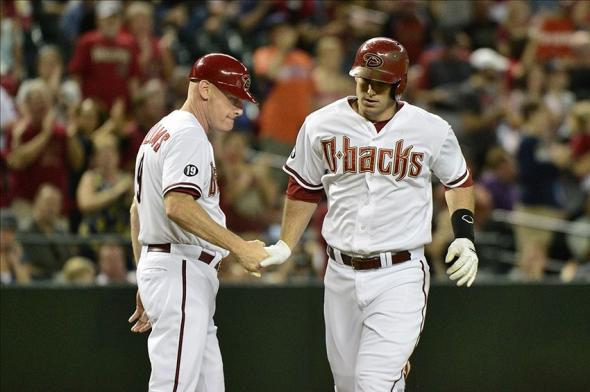 Sep 16, 2013; Phoenix, AZ, USA; Arizona Diamondbacks first baseman Paul Goldschmidt (44) celebrates with third base coach Matt Williams (9) after hitting a 2 run home run during the first inning against the Los Angeles Dodgers at Chase Field. Mandatory Credit: Matt Kartozian-USA TODAY Sports