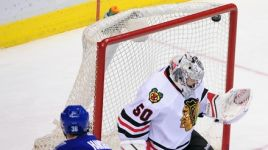 Hansen Hat Trick Topples Blackhawks