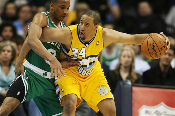 Feb 19, 2013; Denver, CO, USA; Denver Nuggets guard Andre Miller (24) with the ball during the first half against the Boston Celtics at the Pepsi Center. The Nuggets won 97-90. Mandatory Credit: Chris Humphreys-USA TODAY Sports