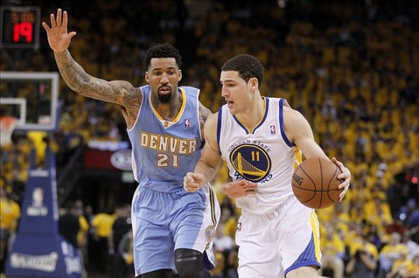 Apr 26, 2013; Oakland, CA, USA; Golden State Warriors guard Klay Thompson (11) drives past Denver Nuggets forward Wilson Chandler (21) in the second quarter during game three of the first round of the 2013 NBA playoffs at Oracle Arena. Mandatory Credit: Cary Edmondson-USA TODAY Sports