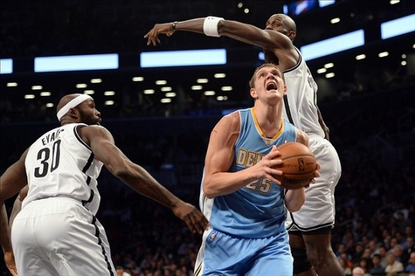 Dec 3, 2013; Brooklyn, NY, USA; Denver Nuggets center Timofey Mozgov (25) drives past Brooklyn Nets power forward Kevin Garnett (2) and power forward Reggie Evans (30) during the first half at Barclays Center. Mandatory Credit: Joe Camporeale-USA TODAY Sports