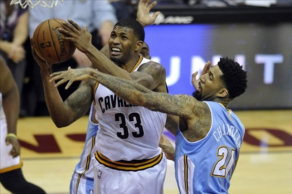 Dec 4, 2013; Cleveland, OH, USA; Cleveland Cavaliers small forward Alonzo Gee (33) drives against Denver Nuggets small forward Wilson Chandler (21) in the second quarter at Quicken Loans Arena. Mandatory Credit: David Richard-USA TODAY Sports
