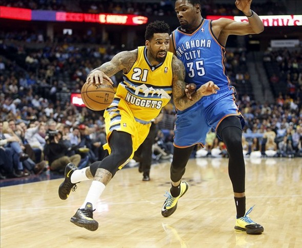 Dec 17, 2013; Denver, CO, USA; Denver Nuggets forward Wilson Chandler (21) drives to the basket against Oklahoma City Thunder forward Kevin Durant (35) during the second half at Pepsi Center. The Thunder won 105-93. Mandatory Credit: Chris Humphreys-USA TODAY Sports