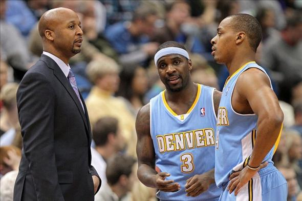 Nov 27, 2013; Minneapolis, MN, USA; Denver Nuggets head coach Brian Shaw talks with guard Ty Lawson (3) and guard Randy Foye (4) against the Minnesota Timberwolves at Target Center. The Nuggets defeated the Timberwolves 117-110. Mandatory Credit: Brace Hemmelgarn-USA TODAY Sports