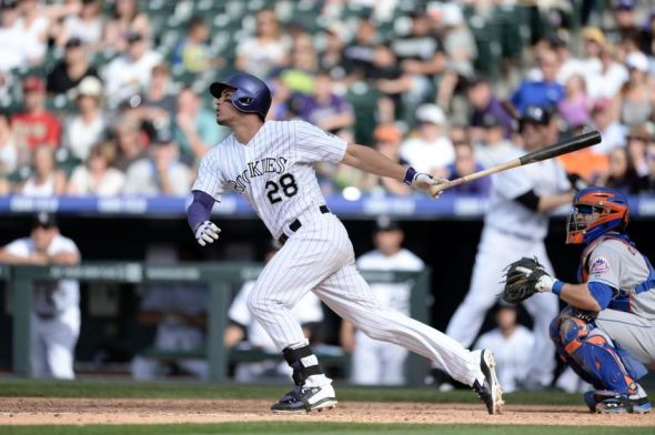 May 4, 2014; Denver, CO, USA; Colorado Rockies third baseman Nolan Arenado (28) fouls line drive to center field in the sixth inning against the New York Mets at Coors Field. The Mets defeated the Rockies 5-1.Mandatory Credit: Ron Chenoy-USA TODAY Sports