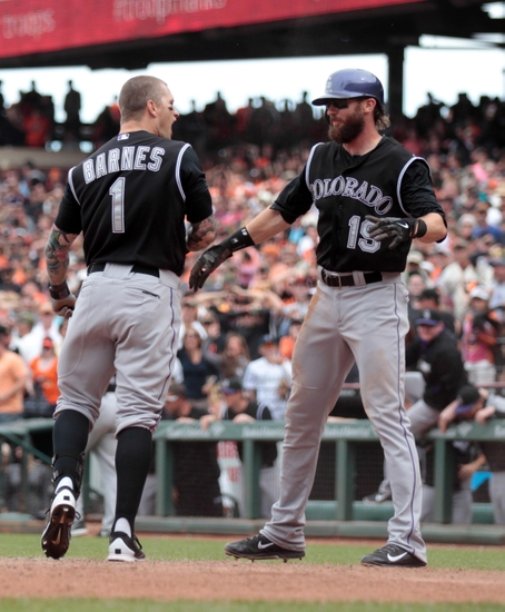 Jun 14, 2014; San Francisco, CA, USA; Colorado Rockies right fielder Brandon Barnes (1) celebrates with center fielder Charlie Blackmon (19) after a two run inside the park home run against the San Francisco Giants during the ninth inning at AT&T Park. The Colorado Rockies defeated the San Francisco Giants 5-4. Mandatory Credit: Kelley L Cox-USA TODAY Sports
