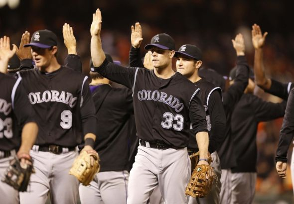 Jun 13, 2014; San Francisco, CA, USA; Colorado Rockies first baseman Justin Morneau (33) congratulate rest of team after the final out against the San Francisco Giants at AT&T Park. Colorado Rockies won 7-4. Mandatory Credit: Bob Stanton-USA TODAY Sports