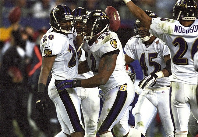 Jan 28, 2001; Tampa, FL, USA; FILE PHOTO; Baltimore Ravens linebacker Ray Lewis (52) celebrates with teammate safety Kim Herring (20) against the New York Giants during Super Bowl XXXV at Raymond James Stadium. The Ravens defeated the Giants 34-7. Mandatory Credit: Richard Mackson-US PRESSWIRE