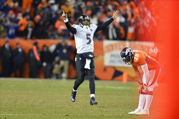 Jan 12 2013; Denver, CO, USA; Baltimore Ravens quarterback Joe Flacco (5) reacts to his touchdown in the fourth quarter against the Denver Broncos of the AFC divisional round playoff game at Sports Authority Field. Mandatory Credit: Ron Chenoy-USA TODAY Sports