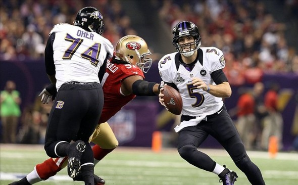 Feb 3, 2013; New Orleans, LA, USA; Baltimore Ravens quarterback Joe Flacco (5) scrambles from San Francisco 49ers defensive end Ray McDonald (91) while protected by Ravens tackle Michael Oher (74) in the first quarter in Super Bowl XLVII at the Mercedes-Benz Superdome. Mandatory Credit: Mark J. Rebilas-USA TODAY Sports