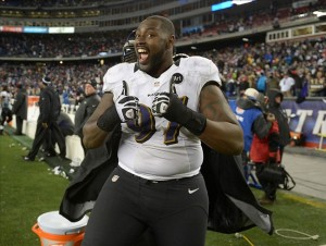 Jan 20, 2013; Foxboro, MA, USA; Baltimore Ravens defensive end Arthur Jones (97) celebrates in the fourth quarter against the New England Patriots in the AFC championship game at Gillette Stadium. The Ravens defeated the Patriots 28-13. Mandatory Credit: Kirby Lee/USA TODAY Sports