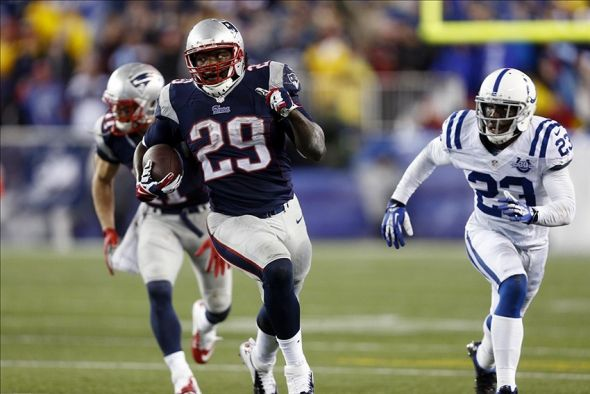 Jan 11, 2014; Foxborough, MA, USA; New England Patriots running back LeGarrette Blount (29) runs against the Indianapolis Colts in the second half during the 2013 AFC divisional playoff football game at Gillette Stadium. Mandatory Credit: Mark L. Baer-USA TODAY Sports