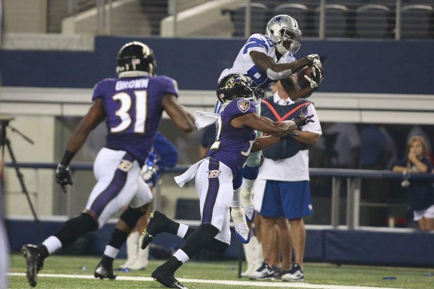 Aug 16, 2014; Arlington, TX, USA; Dallas Cowboys wide receiver Jamar Newsome (85) catches the ball over Baltimore Ravens defensive back Deji Olatoye (32) in the game at AT&T Stadium. Baltimore beat Dallas 37-30. Mandatory Credit: Tim Heitman-USA TODAY Sports
