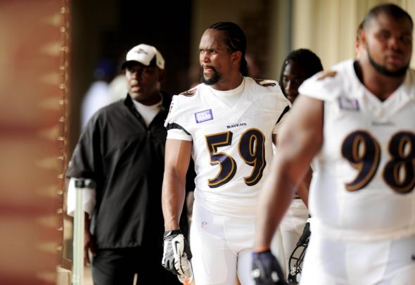 Jun 12, 2013; Owings Mills, MD, USA; Baltimore Ravens linebacker Arthur Brown (59) walks off the field after mini camp at Under Armour Performance Center. Mandatory Credit: Evan Habeeb-USA TODAY Sports