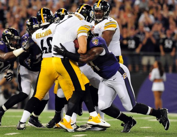 Sep 11, 2014; Baltimore, MD, USA; Baltimore Ravens linebacker Courtney Upshaw (91) is called for roughing the passer on Pittsburgh Steelers quarterback Ben Roethlisberger (7) in the first quarter at M&T Bank Stadium. Mandatory Credit: Evan Habeeb-USA TODAY Sports