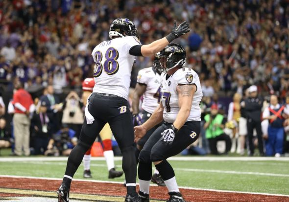 Feb 3, 2013; New Orleans, LA, USA; Baltimore Ravens tight end Dennis Pitta (88) celebrates a first half touchdown with center Matt Birk (77) against the San Francisco 49ers in Super Bowl XLVII at the Mercedes-Benz Superdome. Mandatory Credit: Mark J. Rebilas-USA TODAY Sports