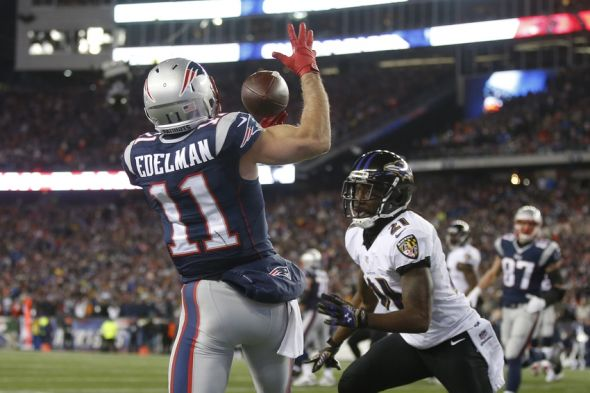 Jan 10, 2015; Foxborough, MA, USA; New England Patriots wide receiver Julian Edelman (11) attempts to catch the ball in front of Baltimore Ravens cornerback Lardarius Webb (21) during the second quarter in the 2014 AFC Divisional playoff football game at Gillette Stadium. Mandatory Credit: David Butler II-USA TODAY Sports