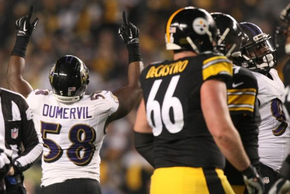 Jan 3, 2015; Pittsburgh, PA, USA; Baltimore Ravens outside linebacker Elvis Dumervil (58) celebrates after sacking Pittsburgh Steelers quarterback Ben Roethlisberger (not pictured) in the second quarter during the 2014 AFC Wild Card playoff football game at Heinz Field. Mandatory Credit: Jason Bridge-USA TODAY Sports