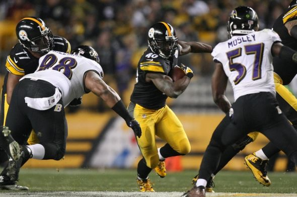 Jan 3, 2015; Pittsburgh, PA, USA; Pittsburgh Steelers running back Josh Harris (40) carries the ball as Baltimore Ravens nose tackle Brandon Williams (98) and Ravens inside linebacker C.J. Mosley (57) defend in the second quarter during the 2014 AFC Wild Card playoff football game at Heinz Field. Mandatory Credit: Jason Bridge-USA TODAY Sports