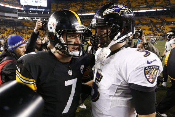 Jan 3, 2015; Pittsburgh, PA, USA; Pittsburgh Steelers quarterback Ben Roethlisberger (7) talks to Baltimore Ravens quarterback Joe Flacco (5) after their 2014 AFC Wild Card playoff football game at Heinz Field. The Ravens won 30-17. Mandatory Credit: Charles LeClaire-USA TODAY Sports