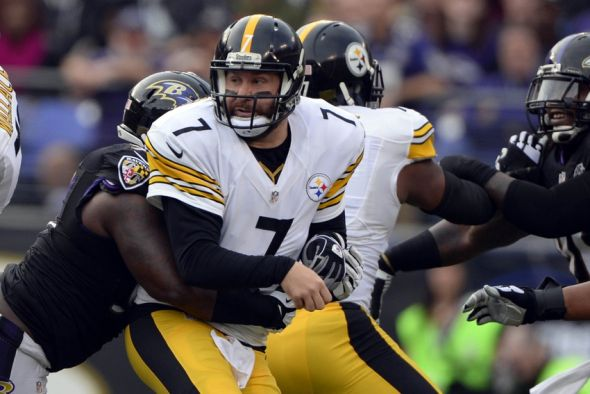 Dec 27, 2015; Baltimore, MD, USA; Pittsburgh Steelers quarterback Ben Roethlisberger (7) get hit as he throws during the second quarter against the Baltimore Ravens at M&T Bank Stadium. Mandatory Credit: Tommy Gilligan-USA TODAY Sports