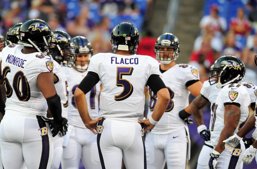 Aug 7, 2014; Baltimore, MD, USA; Baltimore Ravens quarterback Joe Flacco (5) stands in the huddle in the first quarter against the San Francisco 49ers at M&T Bank Stadium. Mandatory Credit: Evan Habeeb-USA TODAY Sports