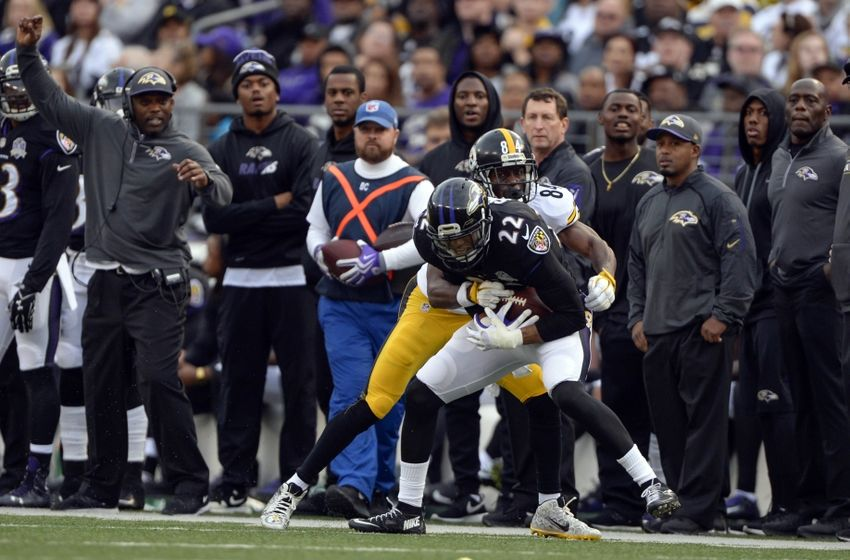 Dec 27, 2015; Baltimore, MD, USA; Baltimore Ravens cornerback Jimmy Smith (22) intercepts Pittsburgh Steelers quarterback Ben Roethlisberger (7) (not pictured) pass intended for wide receiver Antonio Brown (84) during the fourth quarter at M&T Bank Stadium. Baltimore Ravens defeated Pittsburgh Steelers 20-17. Mandatory Credit: Tommy Gilligan-USA TODAY Sports