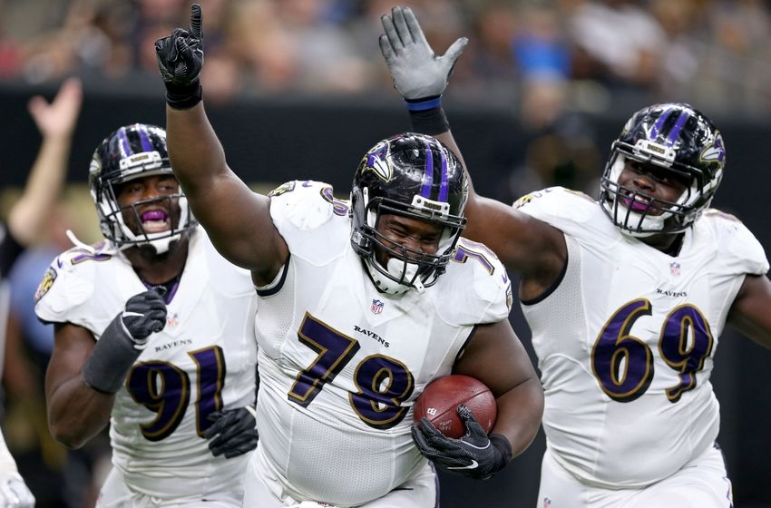 Sep 1, 2016; New Orleans, LA, USA; Baltimore Ravens defensive tackle Michael Pierce (78) celebrates his fumble recovery for a touchdown with teammates Matt Judon (91) and Willie Henry (69) during the second quarter of their game against the New Orleans Saints at the Mercedes-Benz Superdome. Mandatory Credit: Chuck Cook-USA TODAY Sports