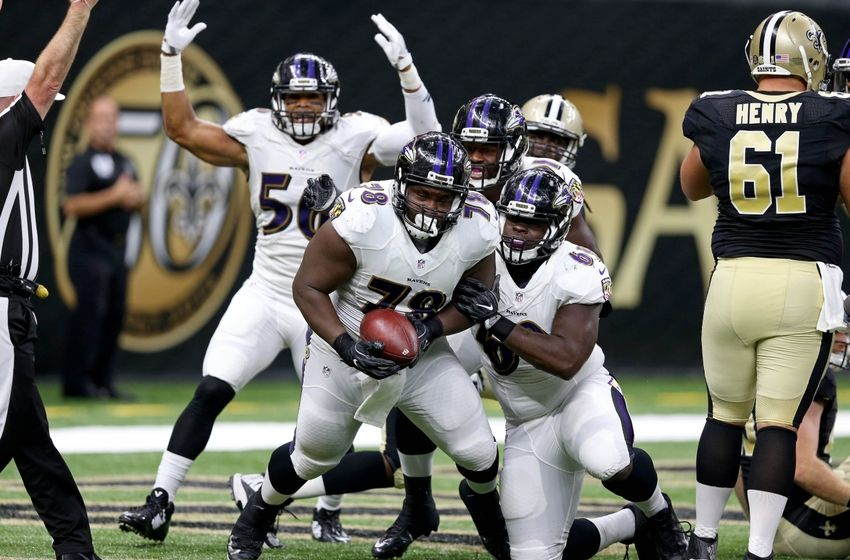 Sep 1, 2016; New Orleans, LA, USA; Baltimore Ravens defensive tackle Michael Pierce (78) celebrates his fumble recovery for a touchdown with teammates Chris Carter (56) and Willie Henry (69) during the second quarter of their game against the New Orleans Saints at the Mercedes-Benz Superdome. Mandatory Credit: Chuck Cook-USA TODAY Sports