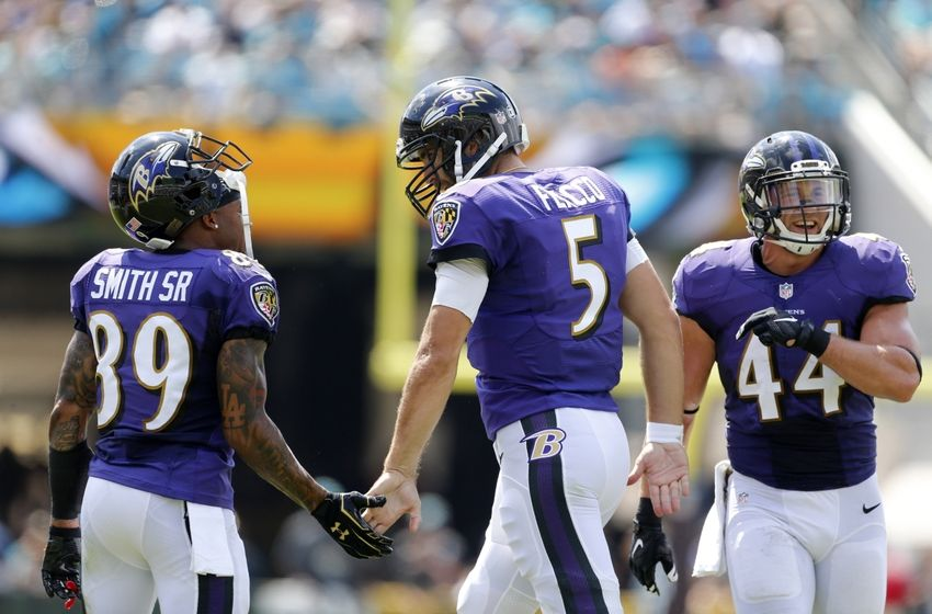 Sep 25, 2016; Jacksonville, FL, USA; Baltimore Ravens quarterback Joe Flacco (5) celebrates with wide receiver Steve Smith (89) and fullback Kyle Juszczyk (44) after scoring a touchdown in the first quarter against the Jacksonville Jaguars at EverBank Field. Mandatory Credit: Logan Bowles-USA TODAY Sports
